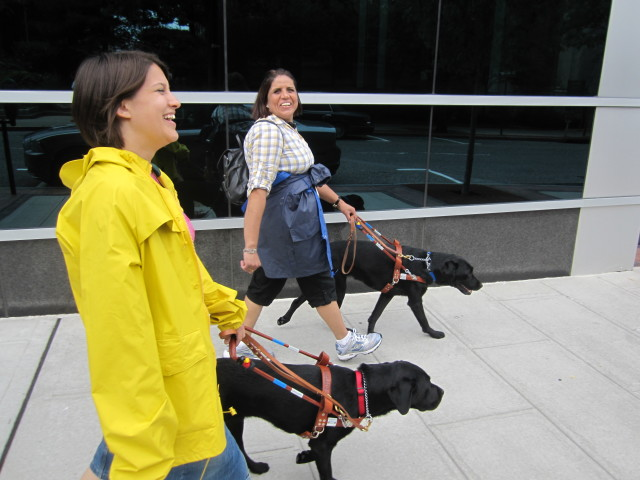Guiding Eyes grads Kate Katulak and Hosta and Nooria Nodrat and Tana