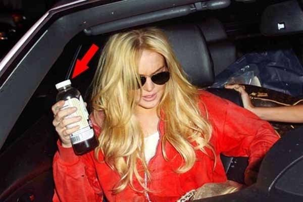Back to Blonde: Lindsay Lohan emerges from an LA hair salon with newly dyed honey-coloured locks
